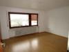 Hier lässt es sich leben! Gut geschnittene 3-Zimmer-Wohnung in Hochpaterre - Wohnzimmer