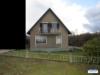 Kleines, freistehendes Einfamilienhaus mit großem Grundstück und Garage - Hausansicht