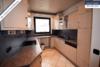 Sehr gepflegtes, freistehendes 1-2 Familienhaus mit 3 Garagen in ruhiger Wohngegend - Küche EG